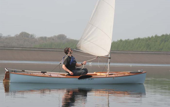 sailing canoe with wooden deck