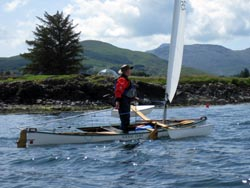 sailing canoe approaching Salen