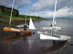 sailing canoes setting off for Mull