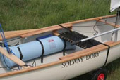 Sailing canoe with seat and side benches