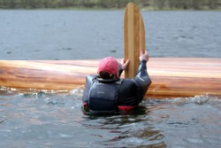 Using leeboard to right a capsized canoe