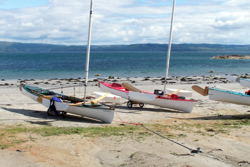 sailing canoes on beach